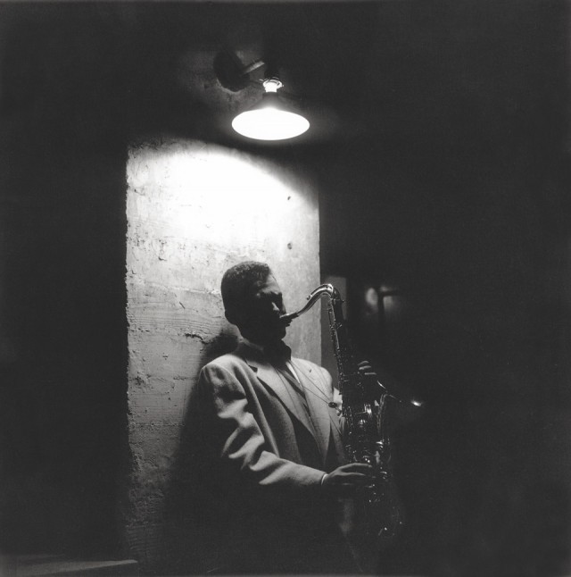 Stan Getz by a stage door on Cosmo Alley, Hollywood. Copyright: William Claxton.